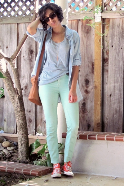 wearing mint green jeans with red sneakers